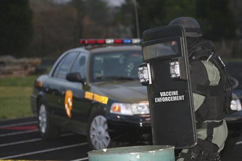 Vaccine-Enforcement-Shield-Car-600